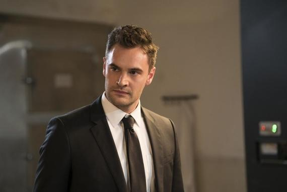 "Into The Dark -- ""The Body"" - A sophisticated hitman with a cynical view on modern society finds his work made more difficult when he has to transport a body on Halloween night, but everyone is enamored by what they think is his killer costume. Wilkes (Tom Bateman), shown. (Photo by: Richard Foreman, Jr. SMPSP/Hulu)"