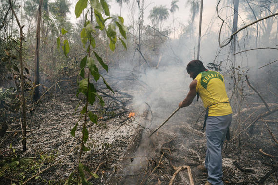 "Vice Investigates -- ""Amazon on Fire"" -- Episode 3 -- Emmy award-winning VICE News correspondent Seb Walker will take audiences to the front lines of the fires blazing throughout the Amazon where politics are rolling back decades of work to save the forest and potentially the planet. As Brazil's President Jair Bolsonaro is confronted with an unprecedented ecological disaster conservationists are placing blame squarely at his feet. Key interviews include French President Emmanuel Macron, an outspoken critic of the government's response, as well as indigenous people and ranchers who have been living on the land for generations but are in bitter opposition over its value, legacy and stewardship. Guajajara indigenous people, shown. (Photo by: Daniel Vergara / VICE Media / Hulu)"
