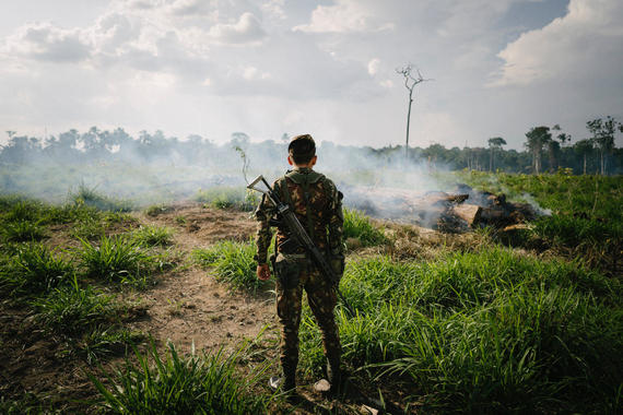 "Vice Investigates -- ""Amazon on Fire"" -- Episode 3 -- Emmy award-winning VICE News correspondent Seb Walker will take audiences to the front lines of the fires blazing throughout the Amazon where politics are rolling back decades of work to save the forest and potentially the planet. As Brazil's President Jair Bolsonaro is confronted with an unprecedented ecological disaster conservationists are placing blame squarely at his feet. Key interviews include French President Emmanuel Macron, an outspoken critic of the government's response, as well as indigenous people and ranchers who have been living on the land for generations but are in bitter opposition over its value, legacy and stewardship. Solider, shown. (Photo by: Daniel Vergara / VICE Media/ Hulu)"