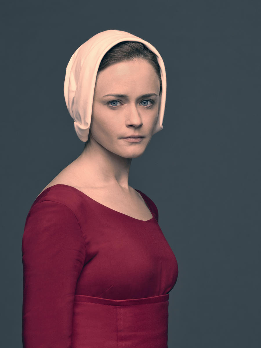 THE HANDMAID'S TALE -- The drama series, based on the award-winning, best-selling novel by Margaret Atwood, is the story of life in the dystopia of Gilead, a totalitarian society in what was formerly part of the United States. Facing environmental disasters and a plunging birthrate, Gilead is ruled by a fundamentalist regime that treats women as property of the state. As one of the few remaining fertile women, Offred (Elisabeth Moss) is a Handmaid in the Commander's household, one of the caste of women forced into sexual servitude as a last desperate attempt to repopulate a devastated world. In this terrifying society where one wrong word could end her life, Offred navigates between Commanders, their cruel Wives, domestic Marthas, and her fellow Handmaids – where anyone could be a spy for Gilead – all with one goal: to survive and find the daughter that was taken from her. Alexis Bledel, shown. (Photo by:Jill Greenberg/Hulu)