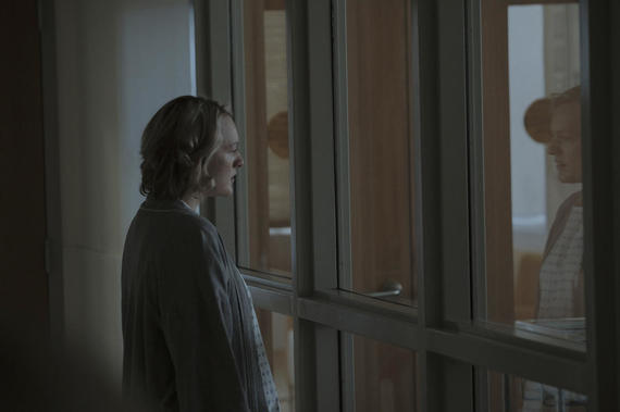 "The Handmaid's Tale -- ""Birth Day"" -- Episode 102 -- Offred and her fellow Handmaids assist with the delivery of Janine's baby, prompting Offred to recall her own daughter's birth. Offred draws closer to Ofglen while dreading a secret meeting with the Commander. Offred (Elisabeth Moss), shown. (Photo by: George Kraychyk/Hulu)"