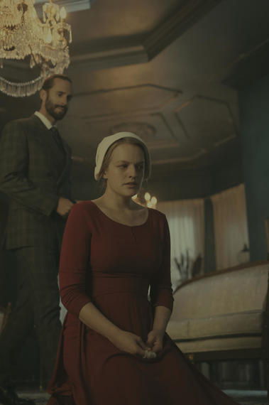"The Handmaid's Tale -- ""Nolite Te Bastardes Carborundorum"" Episode 104 -- Punished by Serena Joy, Offred begins to unravel and reflects on her time with Moira at the Red Center. A complication during the Ceremony threatens Offred's survival with the Commander and Serena Joy. Commander Waterford (Joseph Fiennes) and Offred (Elisabeth Moss), shown. (Photo by: George Kraychyk/Hulu)"