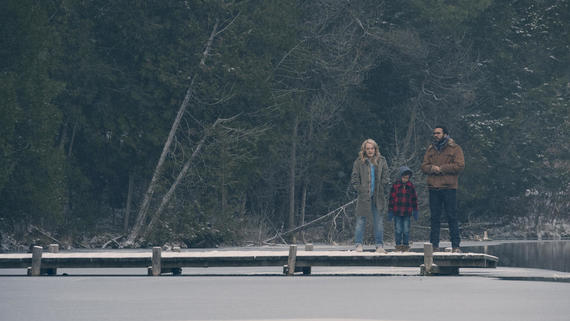 "The Handmaid's Tale -- ""The Other Side"" -- Episode 107 -- Remembering her family's treacherous escape attempt, a shocking revelation from life before Gilead provides a new perspective on Offred's life. Offred (Elisabeth Moss), from left, Hannah (Jordana Blake) and Luke (O-T Fagbenle), shown. (Photo by: George Kraychyk/Hulu)"