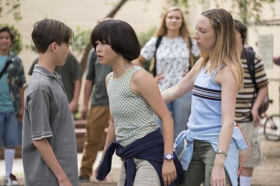 "PEN15 -- ""First Day"" -- Episode 101 -- It's the first day of seventh grade in the year 2000. School rejects, Anna and Maya, get a lot of unexpected attention. Alex (Lincoln Jolly), Maya (Maya Erskine), Anna (Anna Konkle) shown. (Photo by: Alex Lombardi / Hulu)"