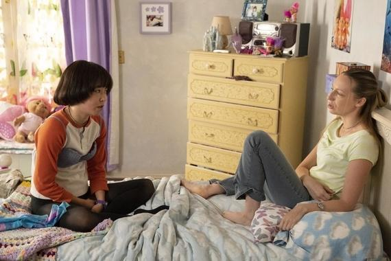 "PEN15 -- ""Wild Things"" - Episode 108 - It's a viewing party to watch the newly released VHS movie, Wild Things. The night gets sexy and Anna and Maya try to keep up. Maya (Maya Erskine) and Anna (Anna Konkle), shown. (Photo by: Alex Lombardi/Hulu)"