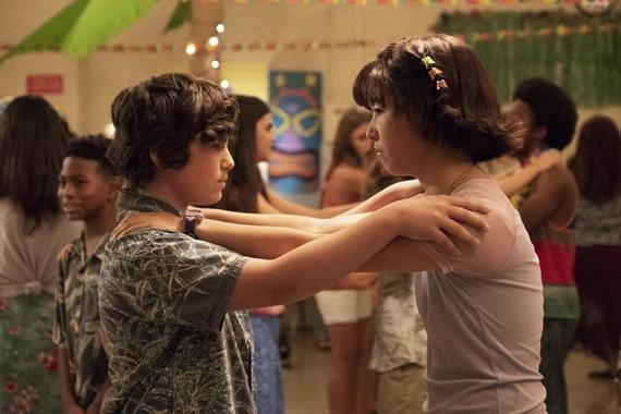 "PEN15 -- ""Dance"" - Episode 110 - It's the night of their first school dance but Anna and Maya are on bad terms. They'll have to navigate this unfamiliar terrain set to billboard hits, by themselves. Sam (Taj Cross) and Maya (Maya Erskine), shown. (Photo by: Alex Lombardi/Hulu)"