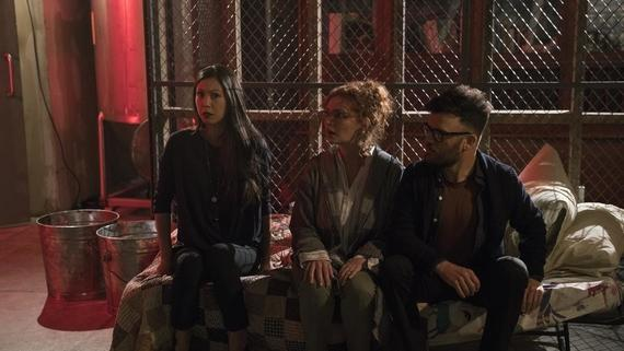 "Runaways -- ""Last Waltz"" -- Episode 211 -- Recovering from their latest challenge, The Runways decide a celebration for one of their own is in order. PRIDE gears up for a fight. Leslie rediscovers her faith, whether she likes it or not. Meanwhile, Karolina's mysterious connection becomes more real. Tina Minoru (Brittany Ishibashi), Stacey Yorkes (Brigid Brannagh), Dale Yorkes (Kevin Weisman) shown. (Photo by: Michael Desmond / Hulu)"