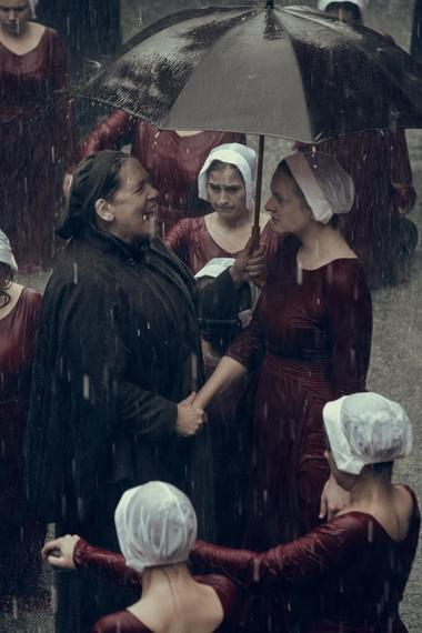"THE HANDMAID'S TALE -- ""June"" - Episode 201 -- Offred reckons with the consequences of a dangerous decision while haunted by memories from her past and the violent beginnings of Gilead. Aunt Lydia (Ann Dowd) and Offred (Elisabeth Moss), shown. (Photo by:George Kraychyk/Hulu)"