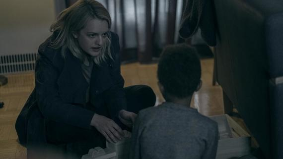 "THE HANDMAID'S TALE -- ""Baggage"" -- Episode 203 -- Offred reflects on her relationship with her mother as she navigates her way through Gilead. In Little America, Moira tries to cope with the trauma she endured. Offred (Elisabeth Moss), shown. (Photo by:George Kraychyk/Hulu)"