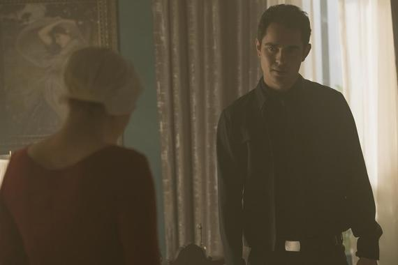 "THE HANDMAID'S TALE -- ""First Blood"" -- Episode 206 -- Offred finds unexpected allies and obstacles in her search for a way to protect Hannah. The Commander prepares for the dedication of a new Red Center. Nick struggles with his new position. Offred (Elisabeth Moss) and Nick (Max Minghella), shown. (Photo by: George Kraychyk/Hulu)"