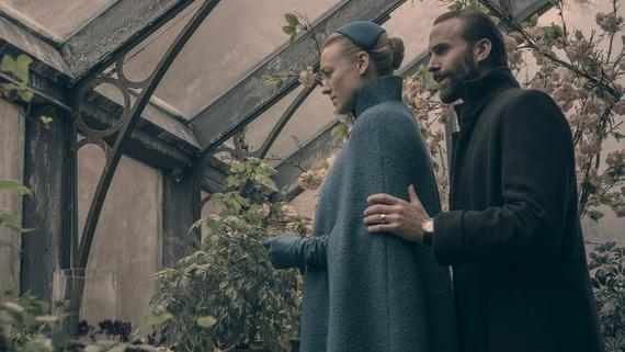 "The Handmaid's Tale -- ""Smart Power"" - Episode 209 - The Waterfords embark on a diplomatic trip abroad. Serena faces the temptation of life outside Gilead. Luke and Moira grapple with survivor's guilt. Offred seeks support from allies. Serena Joy (Yvonne Strahovski) and Commander Waterford (Joseph Fiennes), shown. (Photo by: George Kraychyk/Hulu)"
