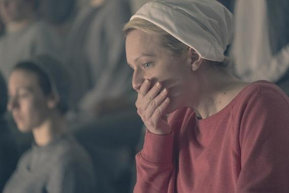 "THE HANDMAID'S TALE -- ""Postpartum"" -- Episode 212 -- Offred is sent to a familiar place. Nick is rocked by Gilead's brutal response to a crime. Emily is assigned to a mysterious new house. Offred (Elisabeth Moss), shown. (Photo by: George Kraychyk/Hulu)"