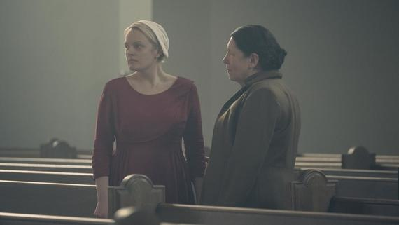 "THE HANDMAID'S TALE -- ""Postpartum"" -- Episode 212 -- Offred is sent to a familiar place. Nick is rocked by Gilead's brutal response to a crime. Emily is assigned to a mysterious new house. Offred (Elisabeth Moss) and Aunt Lydia (Ann Dowd), shown. (Photo by: George Kraychyk/Hulu)"