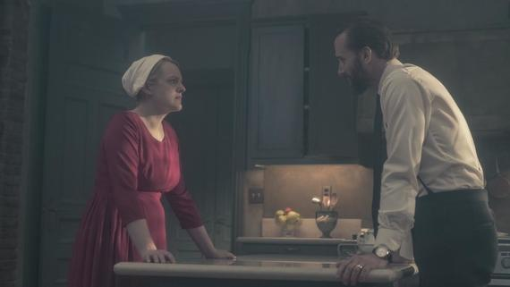 "THE HANDMAID'S TALE -- ""The Word"" -- Episode 213 -- Serena and the other Wives strive to make change. Emily learns more about her new Commander. Offred faces a difficult decision. Offred (Elisabeth Moss) and Commander Waterford (Joseph Fiennes), shown. (Photo by: George Kraychyk/Hulu)"