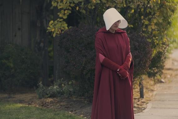 "The Handmaid's Tale -- ""Mary and Martha"" - Episode 302 -- June helps Marthas with a dangerous task while navigating a relationship with her pious and untrustworthy new walking partner. Emily and Luke struggle with their altered circumstances. June (Elisabeth Moss), shown. (Photo by: Elly Dassas/Hulu)"