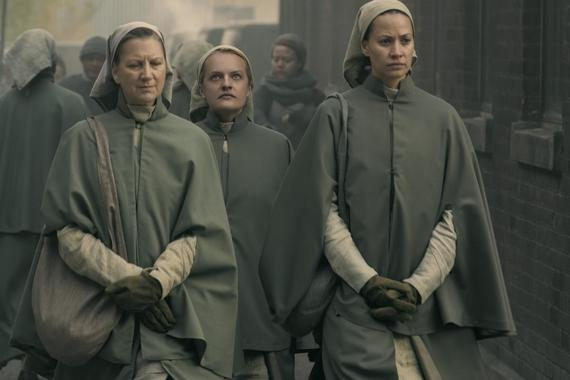 "The Handmaid's Tale -- ""Mary and Martha"" - Episode 302 -- June helps Marthas with a dangerous task while navigating a relationship with her pious and untrustworthy new walking partner. Emily and Luke struggle with their altered circumstances. June (Elisabeth Moss) and Beth (Kristen Gutoskie), shown. (Photo by: Elly Dassas/Hulu)"