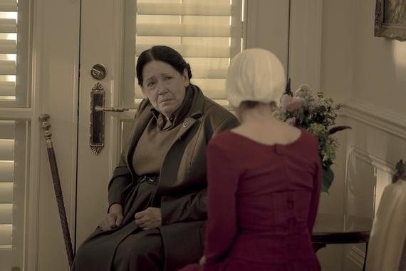 "The Handmaid's Tale -- ""God Bless the Child"" - Episode 304 -- June negotiates a truce in the Waterfords' fractured relationship. Janine oversteps with the Putnam family, and a still-healing Aunt Lydia offers a brutal public punishment. Aunt Lydia (Ann Dowd) and Janine (Madeline Brewer), shown. (Photo by: Elly Dassas/Hulu)"
