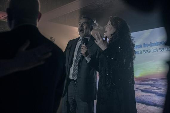 "The Handmaid's Tale -- ""Unfit"" - Episode 308 -- June and the rest of the Handmaids shun Ofmatthew, and both are pushed to their limit at the hands of Aunt Lydia. Aunt Lydia reflects on her life and relationships before the rise of Gilead. Jim Thorne (John Ortiz) and Aunt Lydia (Ann Dowd), shown. (Photo by: Jasper Savage/Hulu)"