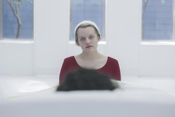 "The Handmaid's Tale -- ""Heroic"" - Episode 309 -- Confined in a hospital, June's sanity begins to fray. An encounter with Serena Joy forces June to reassess her recent actions. June (Elisabeth Moss), shown. (Photo by: Sophie Giraud/Hulu)"