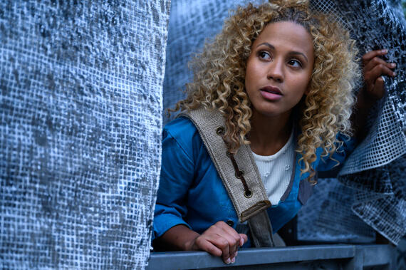 "Utopia Falls -- ""The Light"" - Episode 108 -- As the Exemplar semifinals approach, Aliyah learns an earth-shattering secret about New Babyl. Aliyah (Robyn Alomar), shown. (Photo by: Amanda Matlovich/Hulu)"