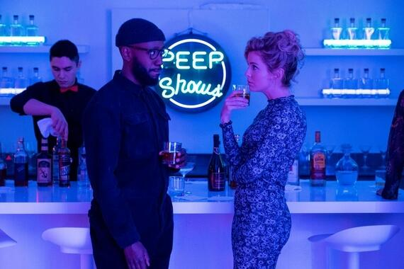 "Woke -- ""Gig E. SmallsÓ - Episode 103 -- Being ÒwokeÓ doesnÕt pay the bills. It also doesnÕt save you from awkward small talk at parties thrown by rich white ladies. Keef (Lamorne Morris) and Adrienne (Rose McIver), shown. (Photo by: Liane Hentscher/Hulu)"