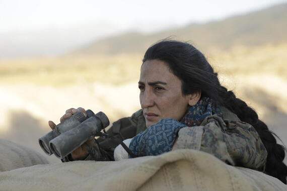 "No Man's Land -- ""Episode 4"" -Episode 104 -- Antoine, Sarya, and the volunteers wait in a Kurdish village for Anna (now called Shamaran) and her battalion, and Antoine dwells on his past involvement in Anna's boyfriend's murder. The Jihadis defeat the Kurdish female fighters on the frontline. When the YPJ battalion arrives, Antoine can see that Shamaran is not his sister. Adar (Roda Canioglu), shown. (Photo by: Sife ELAMINE/Hulu)"