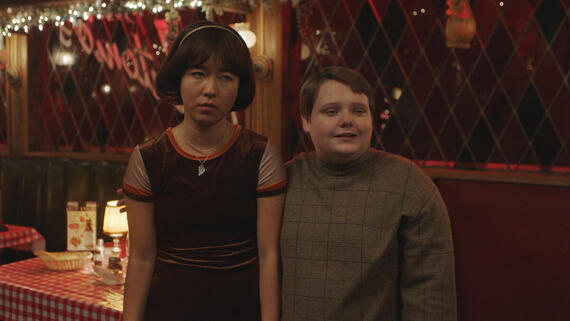 "PEN15 -- ""Opening Night"" - Episode 207 -- It's opening night. Hearts are exposed, forcing both Anna and Maya to grow up. Maya Ishii-Peters (Maya Erskine), Gabe (Dylan Gage), shown. (Photo by: Courtesy of Hulu)"