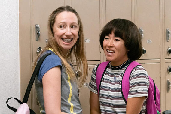 "PEN15 -- ""Play"" - Episode 206 -- The school play has been cast. Maya has the opportunity to get her actual first kiss. Anna struggles to find herself. Anna Kone (Anna Konkle) and Maya Ishii-Peters (Maya Erskine), shown. (Photo by: Lara Solanki/Hulu)"