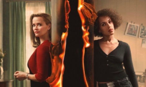 Two women separated by a burning wall