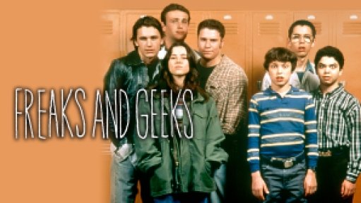 Cast of Freaks and Geeks standing in front of lockers.