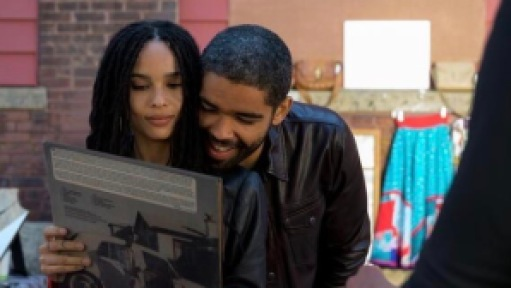 High Fidelity's Zoë Kravitz and Kingsley Ben-Adir looking at a record.