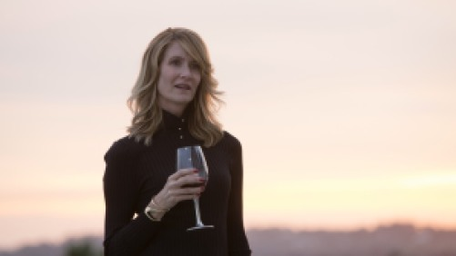 Laura Dern holing a wine glass starring in Big Little Lies