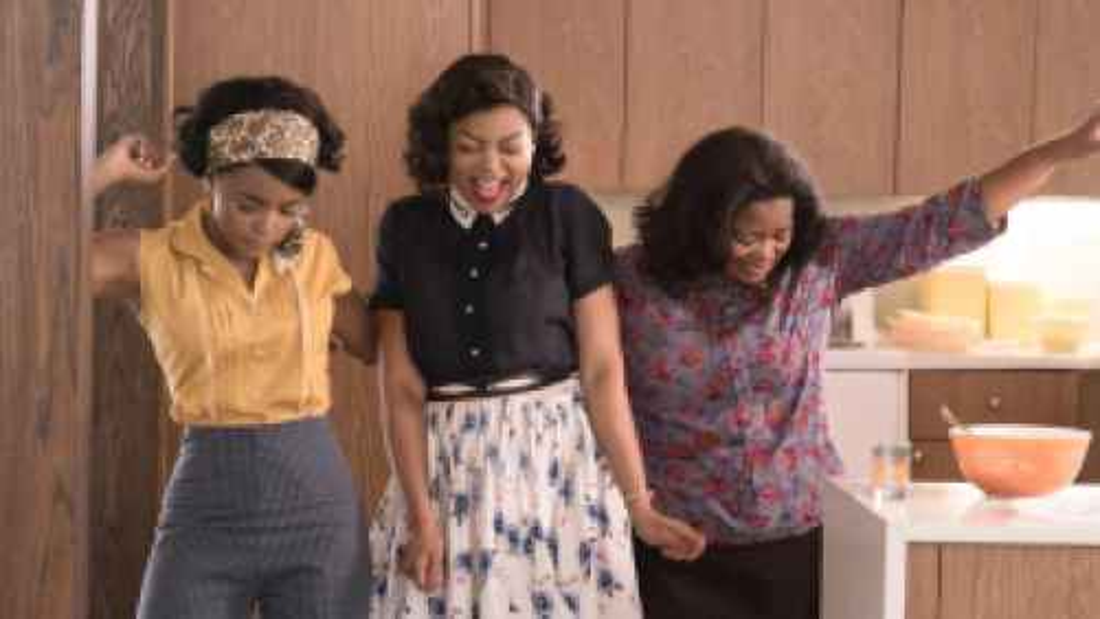 Women celebrating in the movie Hidden Figures