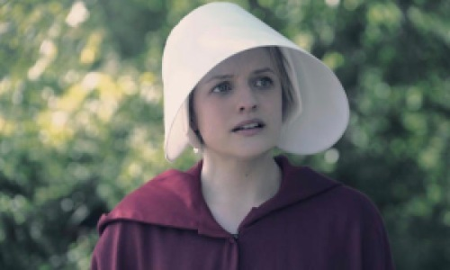 Woman wearing a red cloak and bonnet in The Handmaid's Tale