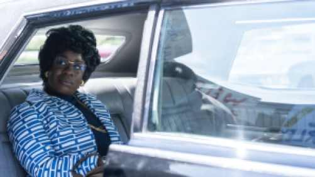 Uzo Aduba sitting in the car, starring in Mrs. America