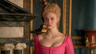 Elle Fanning wearing a pink gown starring as Catherine the Great in The Great