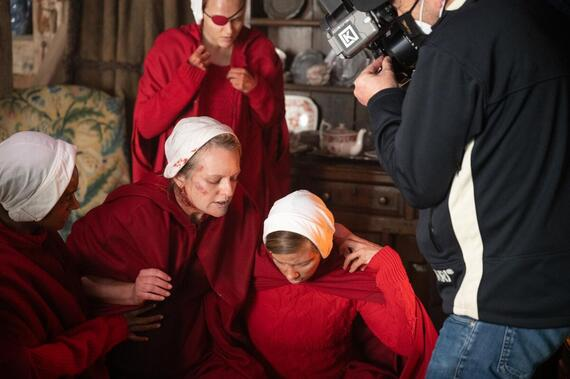 "The Handmaid's Tale -- ""Pigs"" - Episode 401 -- On the run after the end of Season 3, an injured June and the fugitive Handmaids find refuge at a farm, where the 14-year-old Wife nurses June back to health. June restores her role as the women's leader. In Gilead, an imprisoned Lawrence tries to avoid a death sentence, and Aunt Lydia reels from the loss of 86 children on Angels' Flight. The combative Waterfords, in custody in Toronto, learn of June's feat. June (Elisabeth Moss), shown. (Photo by: Sophie Giraud/Hulu)"