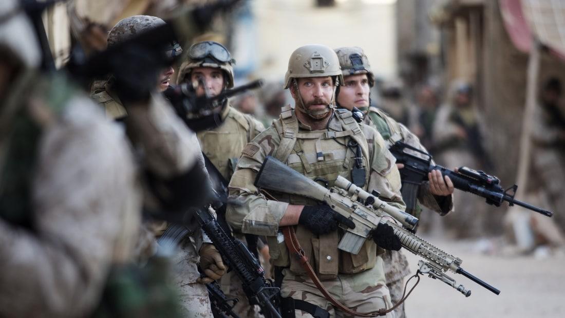 Bradley Cooper portraying U.S. Navy SEAL Chris Kyle in American Sniper.