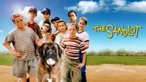 Kids from The Sandlot standing on the baseball field with the dog