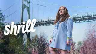 Title art for season 3 of Shrill featuring Aidy Bryant standing by a bridge.