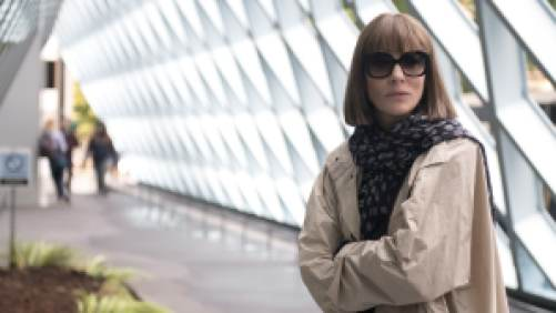 Cate Blanchett posing in a trench coat and sunglasses in Where'd You Go Bernadette.