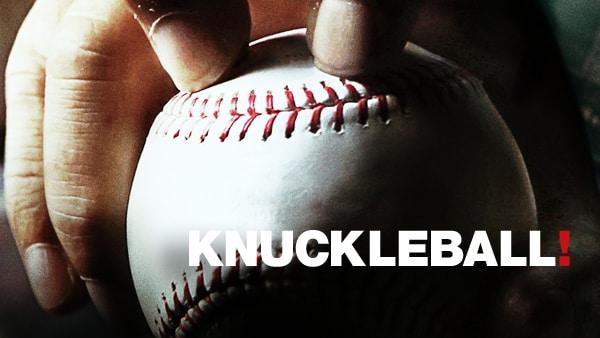 Close up of someone holding a baseball