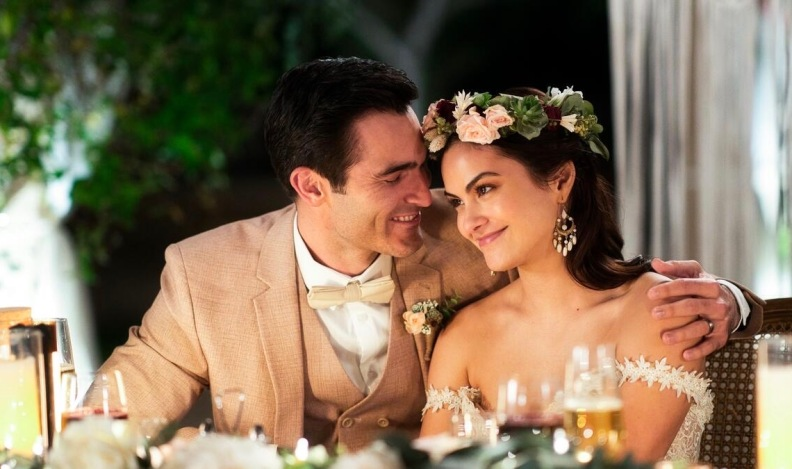Tala and Abe on their wedding day in the Hulu Original movie Palm Springs.