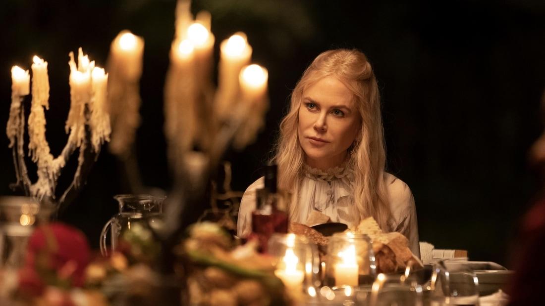 Masha (Nicoe Kidman) sitting at a set dinner table in Nine Perfect Strangers.