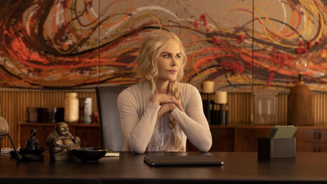 Masha (Nicole Kidman) sitting at a desk in the series Nine Perfect Strangers.