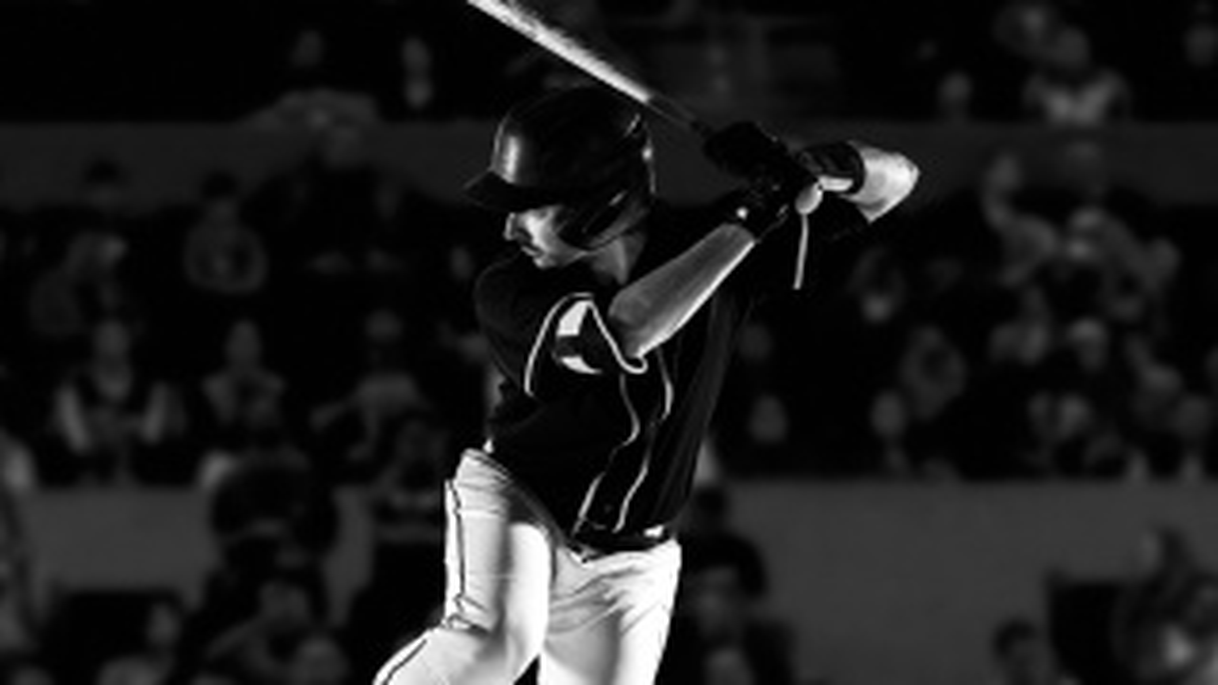 Baseball player swinging a baseball bat.